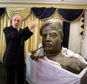 TO GO WITH AFP STORY BY MOHAMAD ALI HARISSI The bust of former Iraqi leader Saddam Hussein and the actual rope used to hang him, are on display in the living room of former national security adviserMowaffak al-Rubaie (gesturing), seen during an interview with the AFP where he gave details of his execution, on December 23, 2013. Saddam was executed by hanging in Iraq in the early hours of December 30, 2006, in Baghdad after he was captured by US military forces hidding in an underground hole at a farm in the village of ad-Dawr, near his hometown of Tikrit in northern Iraq on December 13, 2003 AFP PHOTO/SABAH ARAR